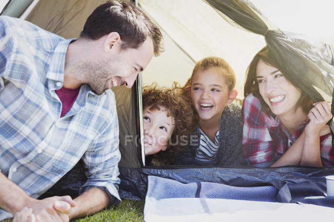 Smiling family in tent during daytime — Stock Photo
