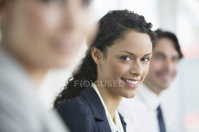 Businesswoman smiling in meeting — Stock Photo