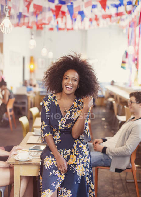 Portrait enthusiastic woman with afro in cafe — Stock Photo