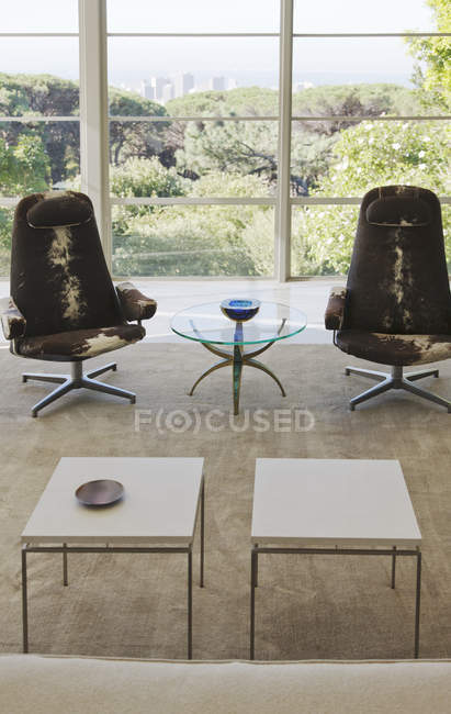 Chairs and tables in modern living room — Stock Photo