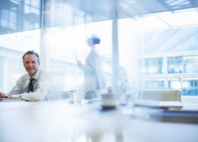 Businessman sitting in conference room — Stock Photo