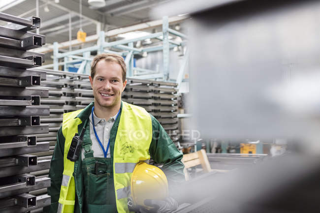 Portrait smiling worker in protective workwear in steel factory — Stock Photo