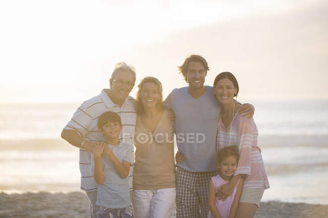 Family smiling together on beach — Stock Photo