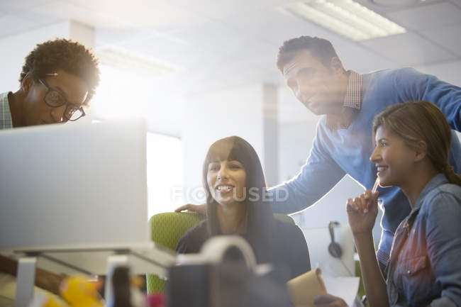 Business people talking at desk in office — Stock Photo
