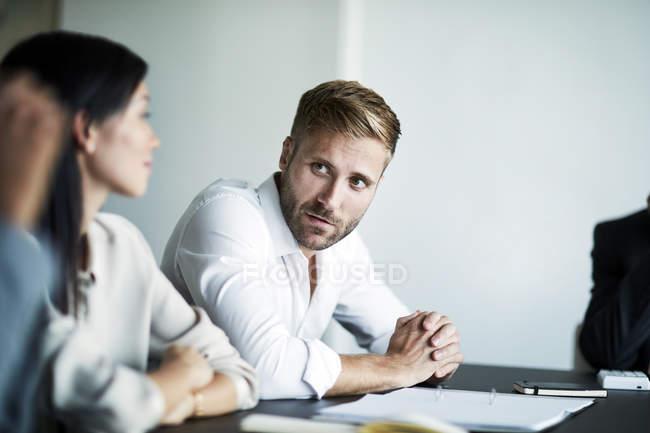 Businessman talking in meeting — Stock Photo