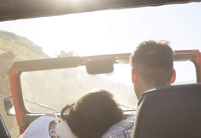 Couple driving sport utility vehicle — Stock Photo