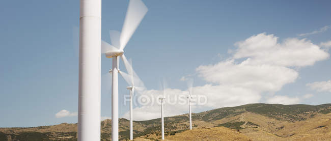 Wind turbines spinning in rural landscape — Stock Photo