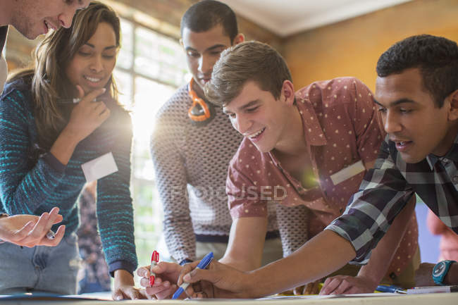 Creative business people working in sunny office — Stock Photo