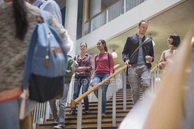 College students descending stairway together — Stock Photo