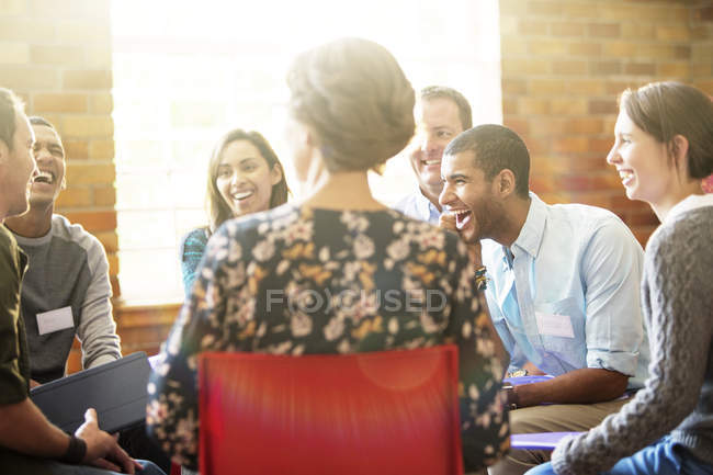 People laughing in group therapy session — Stock Photo