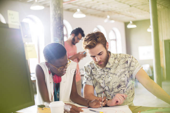 Creative business people drawing diagram in office — Stock Photo