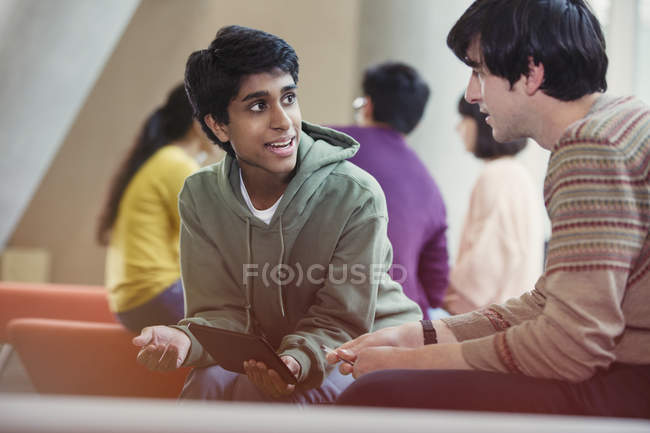 Male college student studying using digital tablet — Stock Photo