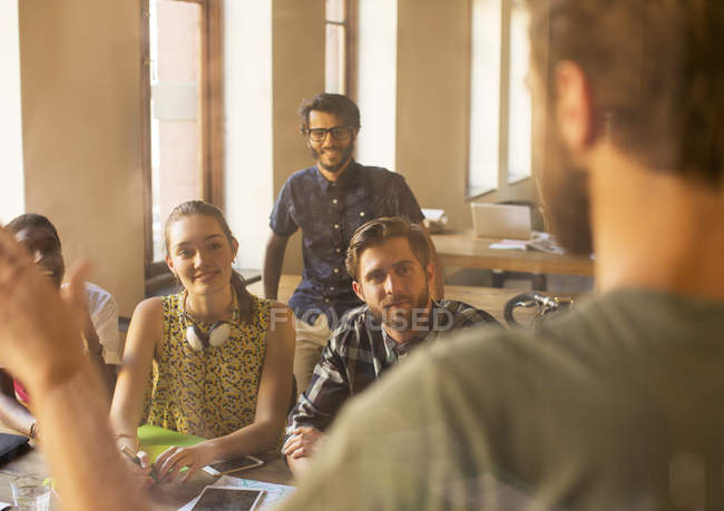 Casual businessman leading meeting in office — Stock Photo
