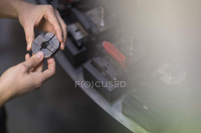 Worker examining part in steel factory — Stock Photo