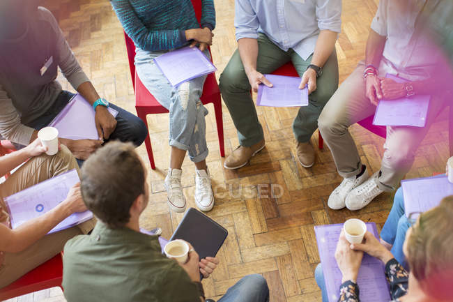 Group therapy session forming circle — Stock Photo