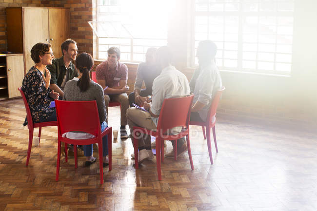 Group therapy session in circle in sunny community center — Stock Photo