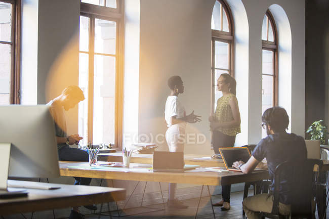 Businesswomen talking together at modern office — Stock Photo
