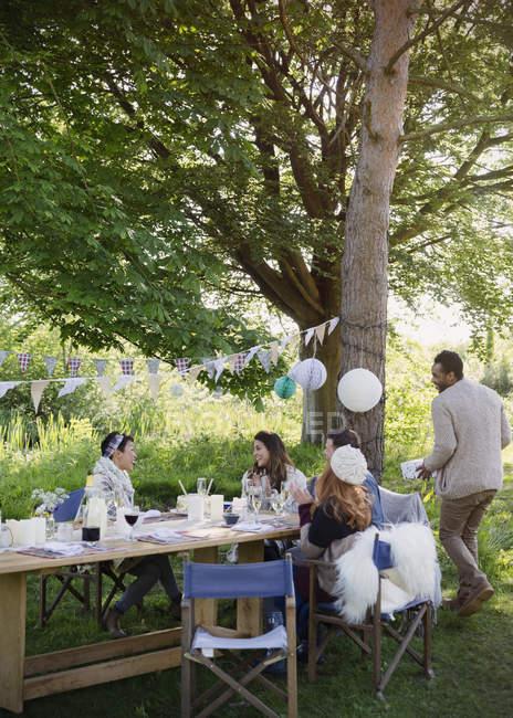 Friends enjoying garden party birthday lunch — Stock Photo