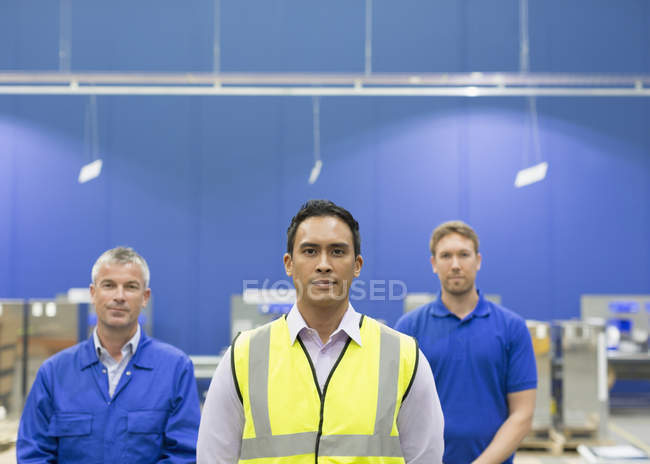 Portrait confident manager and workers in steel factory — Stock Photo