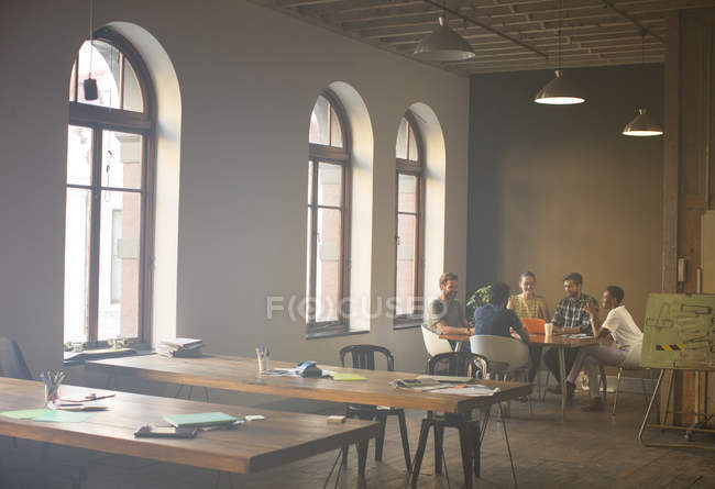 Casual business people meeting at table in office — Stock Photo
