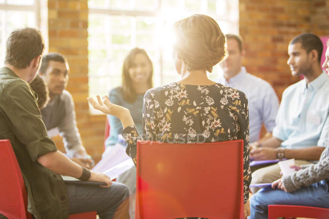 Woman speaking in group therapy session — Stock Photo