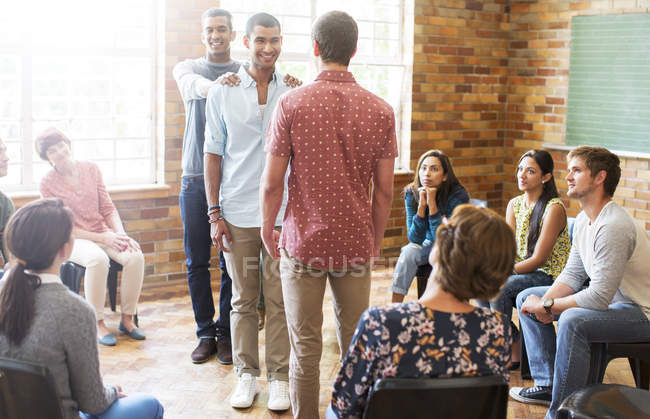 Supportive men at group therapy session — Stock Photo