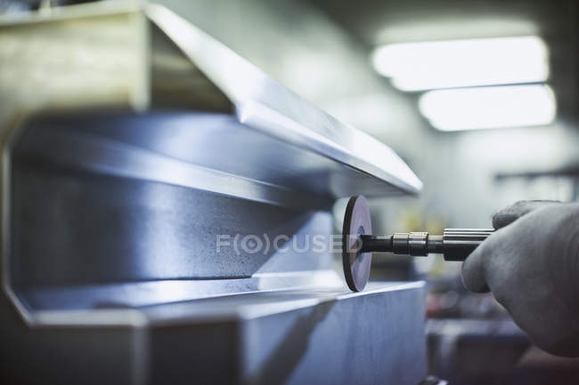 Close up worker sanding steel in steel factory — Stock Photo