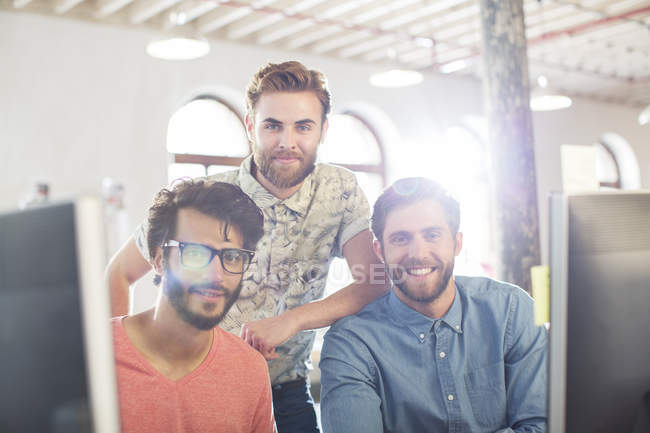 Portrait casual businessmen smiling in office — Stock Photo