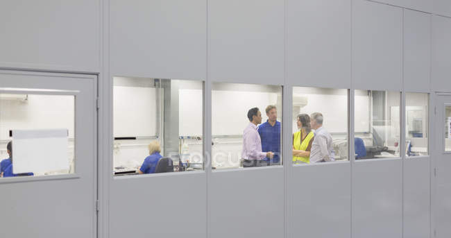 Managers and workers in steel factory office — Stock Photo