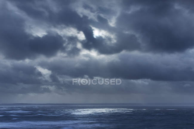 Dark clouds in overcast sky over ocean, Devon, United Kingdom — Stock Photo