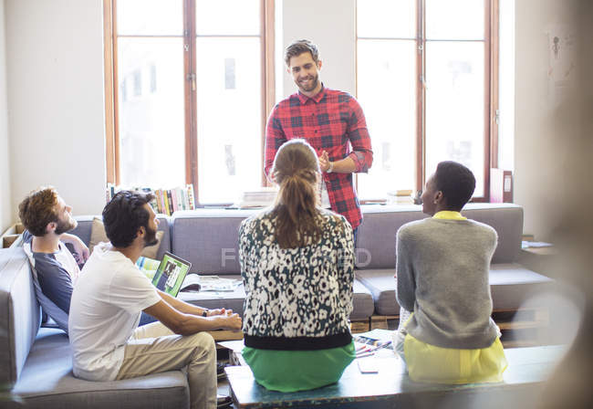 Creative businessman leading meeting at modern office — Stock Photo