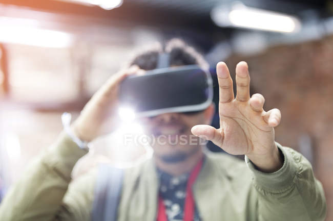 Portrait man trying virtual reality simulator glasses reaching — Stock Photo