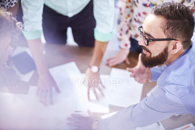 Creative businessman leading meeting in modern cafe — Stock Photo