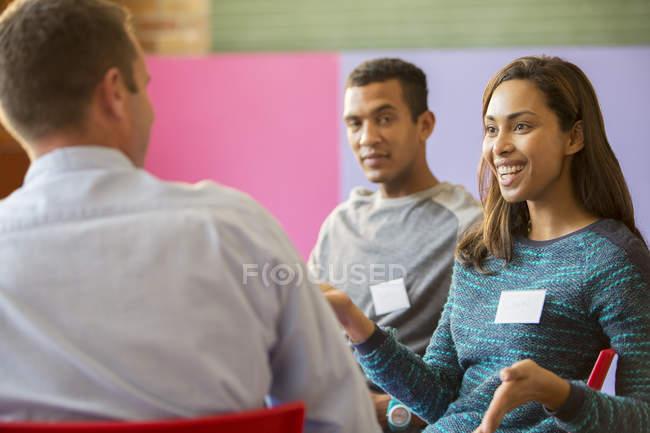 Woman speaking in meeting indoors — Stock Photo