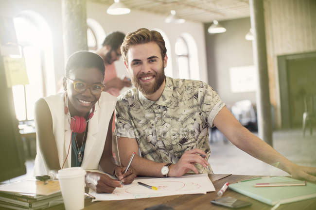 Portrait creative business people drawing diagram in office — Stock Photo