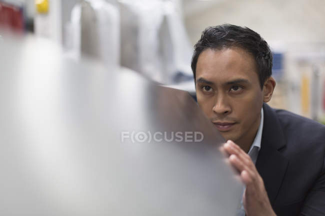 Focused manager inspecting steel in steel factory — Stock Photo