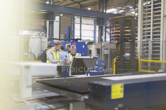 Supervisor and workers in steel factory — Stock Photo