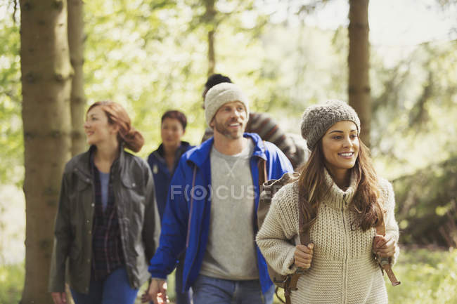 Friends hiking in woods during daytime — Stock Photo