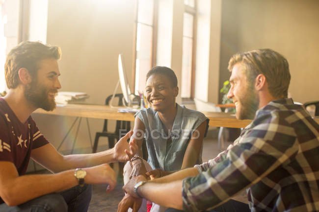 Casual business people talking in meeting in office — Stock Photo
