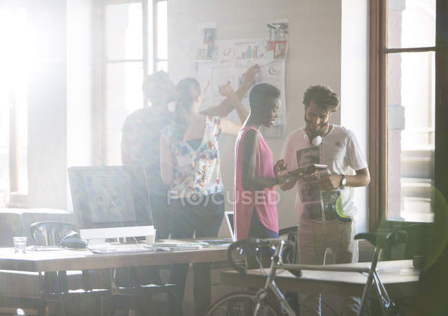 Creative business people brainstorming and working in office — Stock Photo