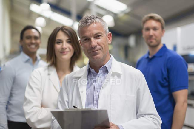 Portrait smiling engineer team in steel factory — Stock Photo