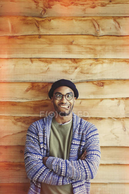 Portrait man making a face outside cabin — Stock Photo
