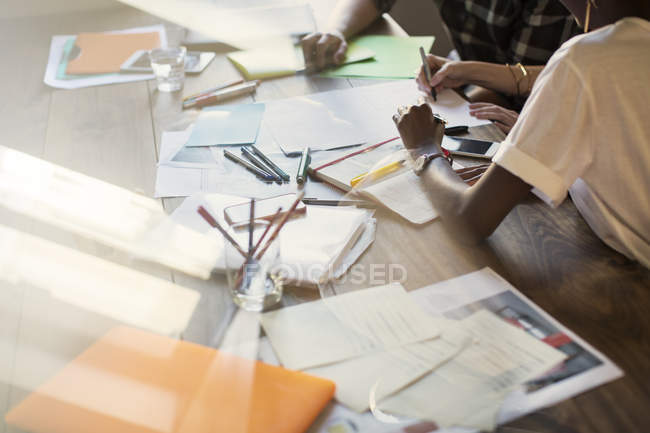 Cropped image of creative business people brainstorming in meeting — Stock Photo