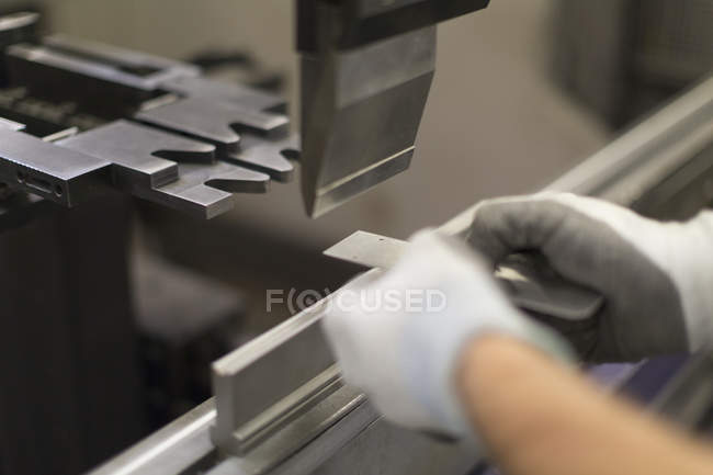 Close up worker using machinery in steel factory — Stock Photo