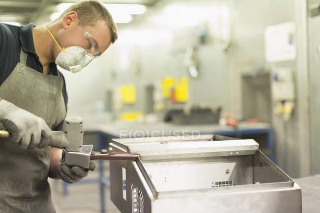 Worker using equipment in steel factory — Stock Photo