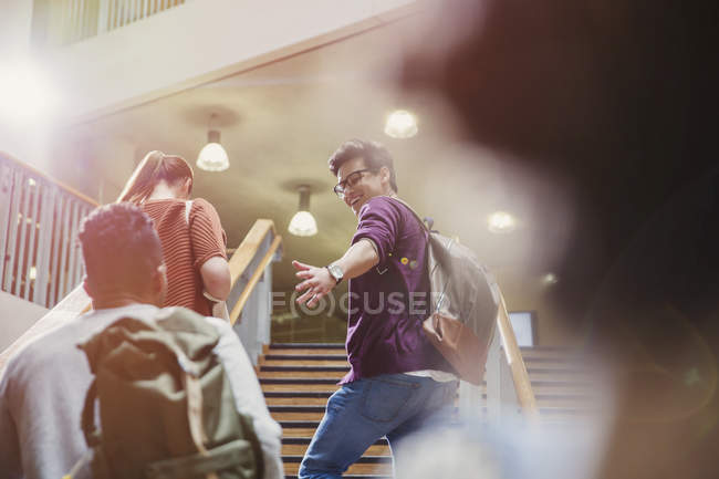 College students ascending stairway together — Stock Photo