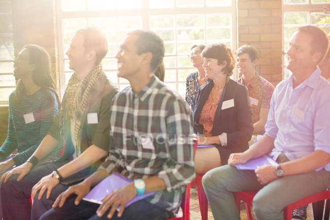 Audience smiling in community center — Stock Photo