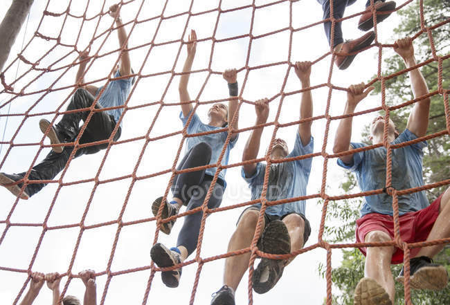 Team climbing net on boot camp course — Stock Photo