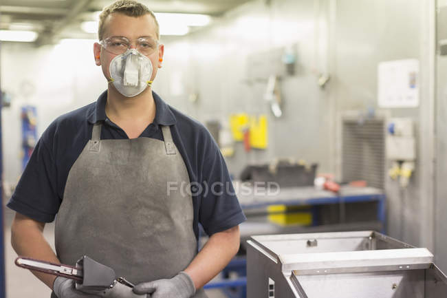 Portrait confident worker wearing protective mask in steel factory — Stock Photo