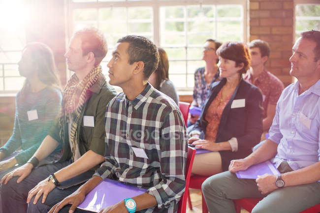Attentive audience listening in community center — Stock Photo